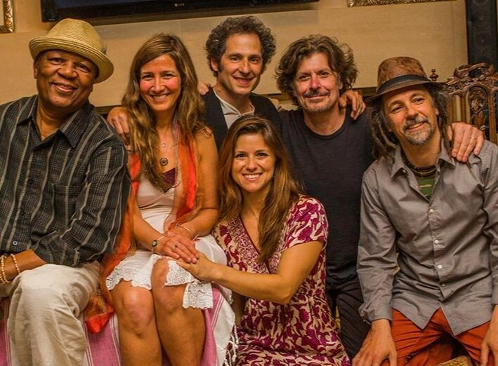 The Kirtan Gypsies :  Bakithi Kumalo ,  Daphne Motzkin ,  Jonathan Dichter , Sarra Kaufman, Eric Bazilian and  David Langlois .