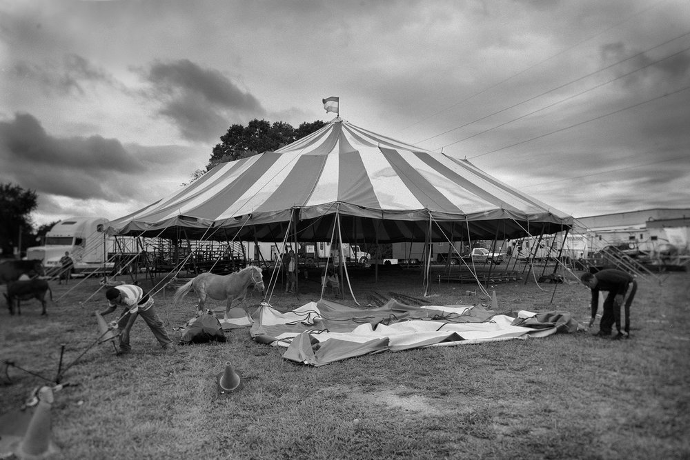 Workers pack up the tent after the show –the circus moves to the next destination.