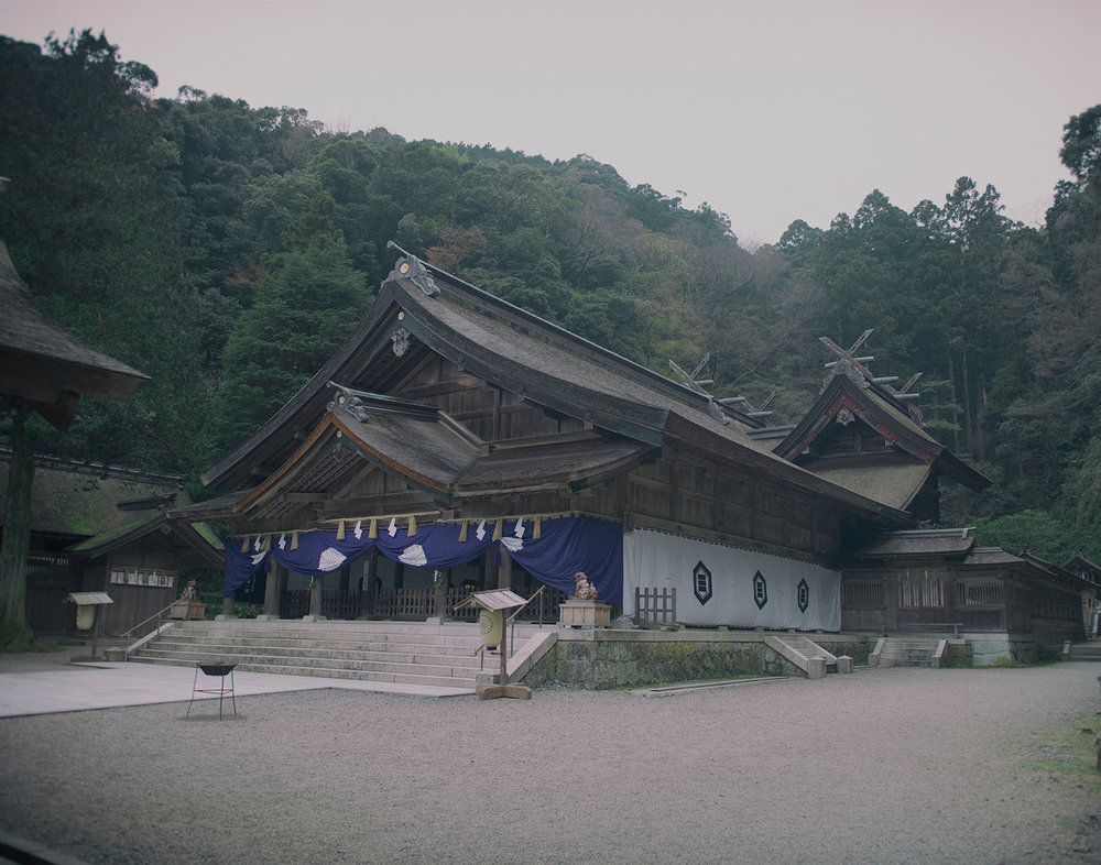 """Surrounded by the rich forest of the Shimane Peninsula and overlooking Miho Bay, Miho Shrine is the head of more than 3,000 dedicated to Ebisu, divinity of the sea, merchants and music.  This small town of Mihonoseki is home to many rituals. Two of the most important ones are based on stories in the Kojiki (""""Record of Ancient Matters""""), the oldest existing record of Japanese mythology."""