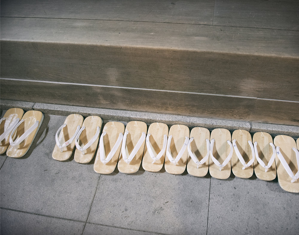 Kannushi (Shinto priest) zouri sandals lined up inside the shrine.