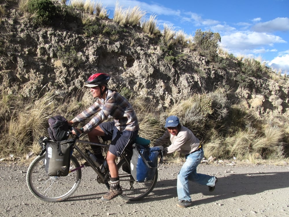 Get outside on a bike and you´ll meet all sorts of people - We met Estaben on a dirt road in Peru and he pushed us up the hill.