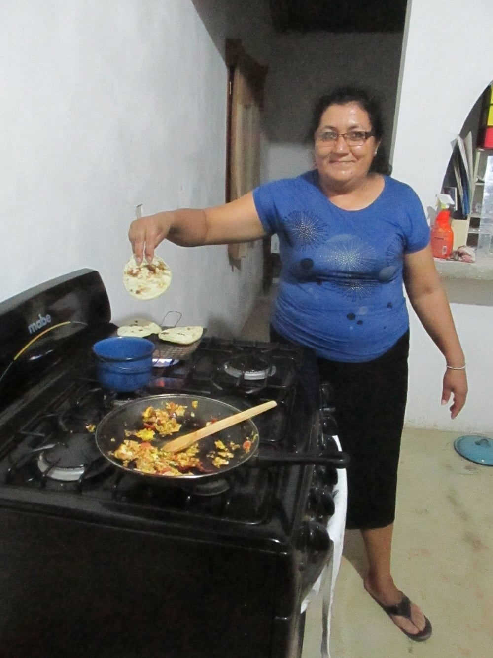Mireira shows off her delicious corn tortillas.