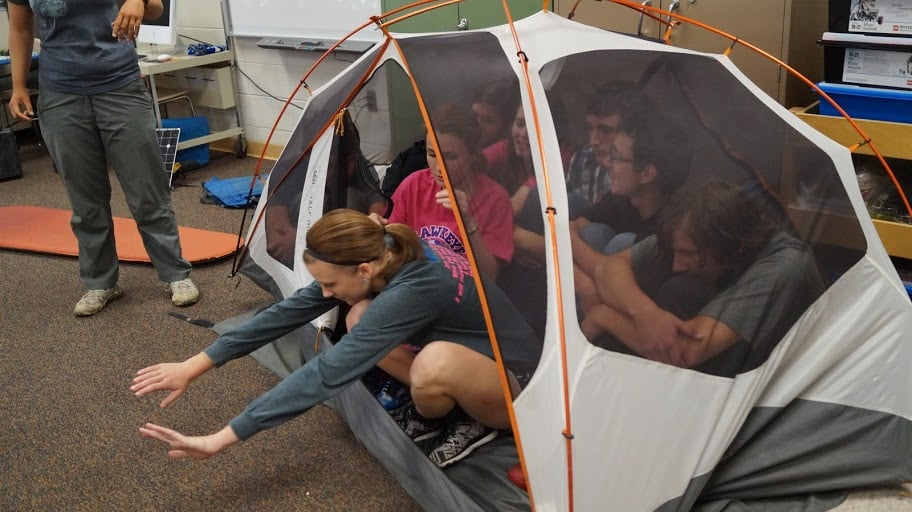 Our Presentation included stories, photos and hands on experience with our gear. While some kindergarten classes managed to fit 15 kids in the tent, these eighth graders only managed 8.