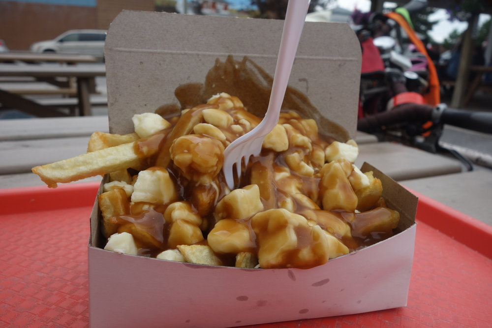 Poutine, a suitable snack for hungry cyclists, is worth trying.