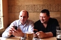 two-men-using-mobile-phones-width-200.jpg