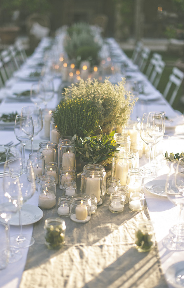 3.  RUSTIC LUXURY; AN AL FRESCO TUSCAN WEDDING : The beauty of Italian dining is that it's simple; all you need is a  crisp white tablecloth ,  natural linen runner , an abundance of  candles ,  votive holders  and fresh greenery to create your very own Italian feast.