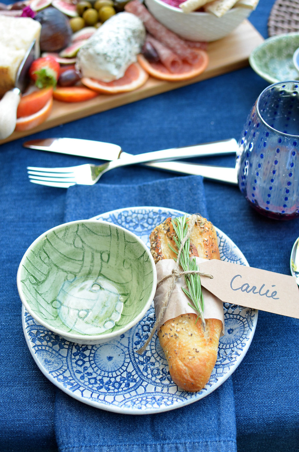 Shown here: Wonki Ware Blue Ferris Accent Plate, with a Wonki Ware Green Wheel Ramekin.