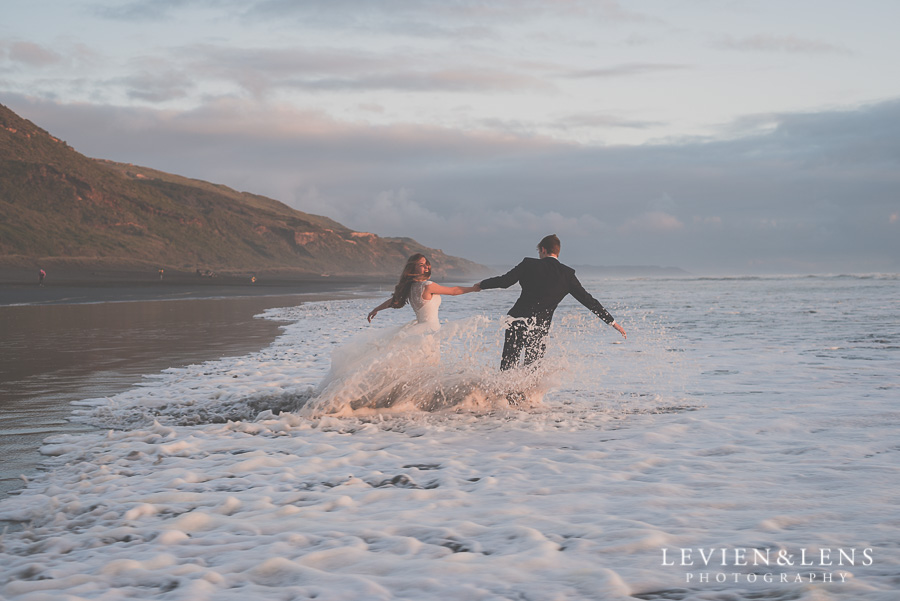 Bride and Groom in wild waves