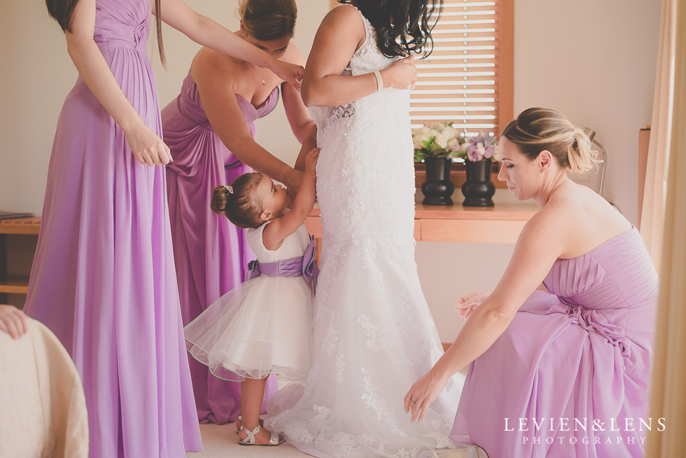bridesmaids putting shoes on bride {Auckland wedding photographer}