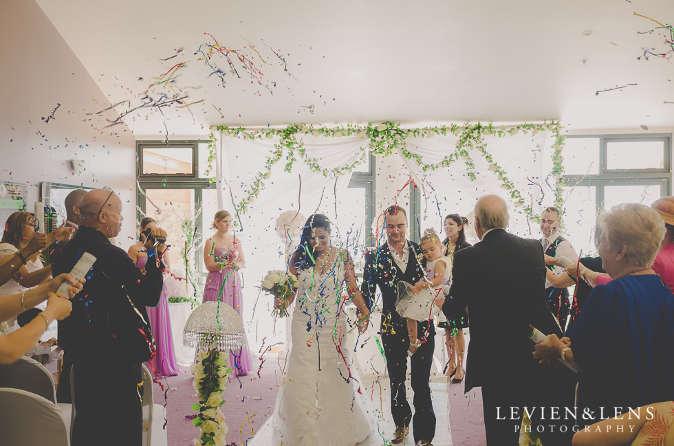 bride and groom down aisle end of wedding ceremony {New Zealand wedding photographer}
