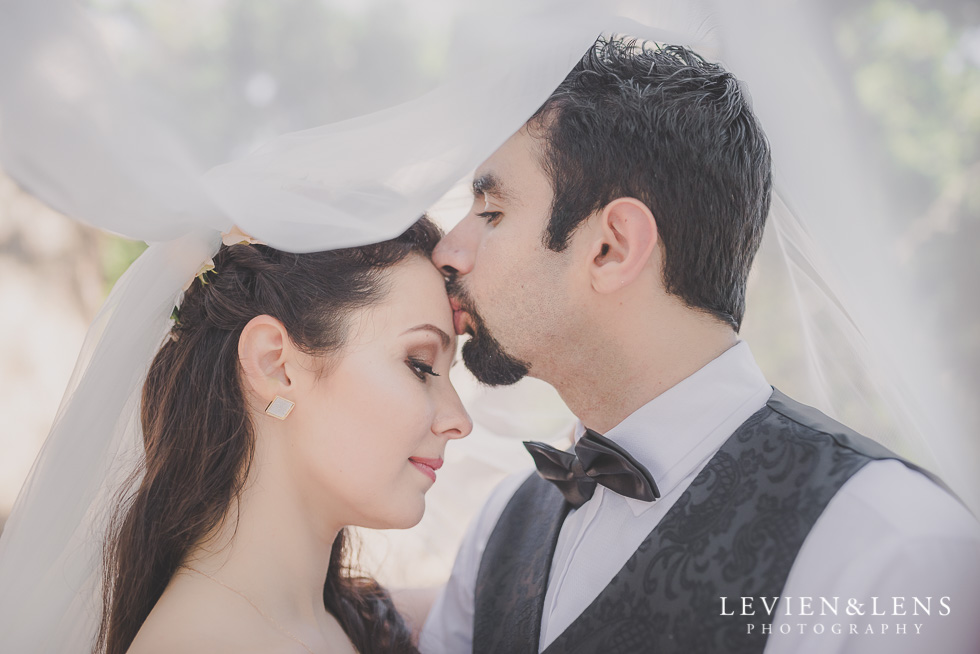 groom kiss bride forehead under vail Parnell on the Rose Garden {Auckland lifestyle wedding photographer}