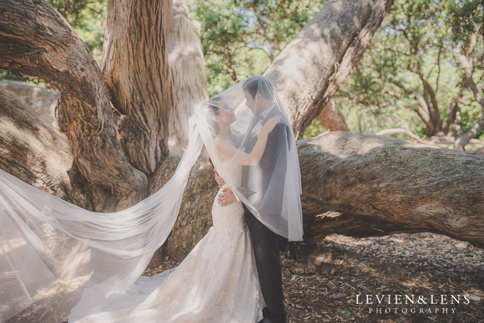 bride and groom under vail Parnell on the Rose Garden {Auckland lifestyle wedding photographer}