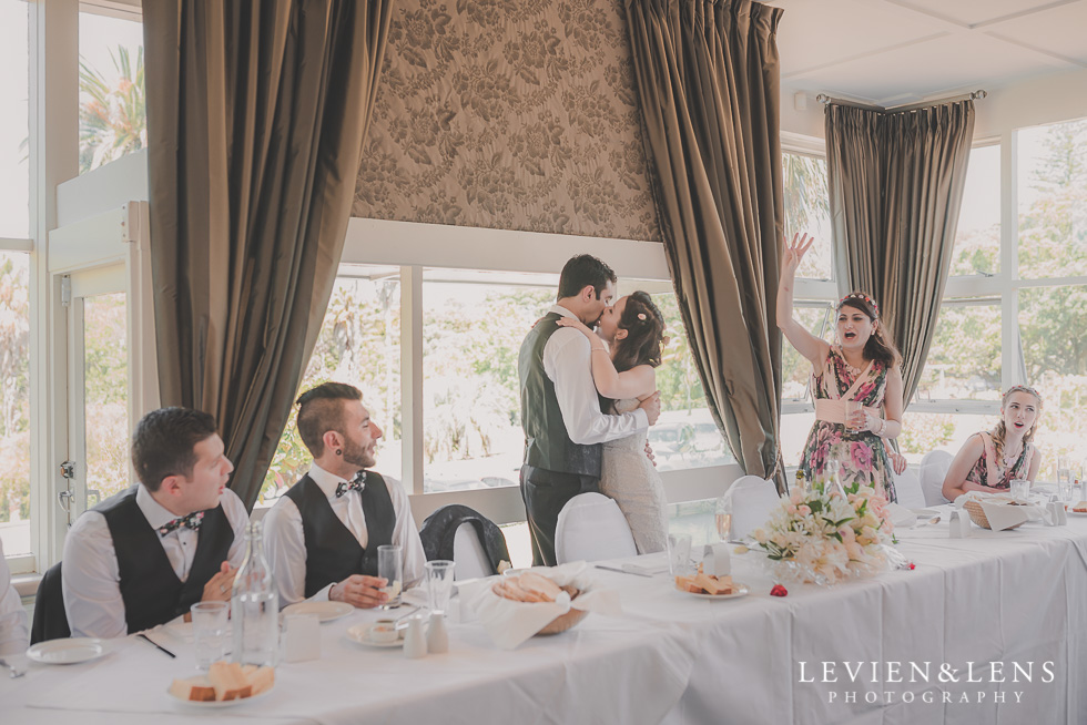 couples kiss Parnell on the Rose Garden {Auckland lifestyle wedding photographer}