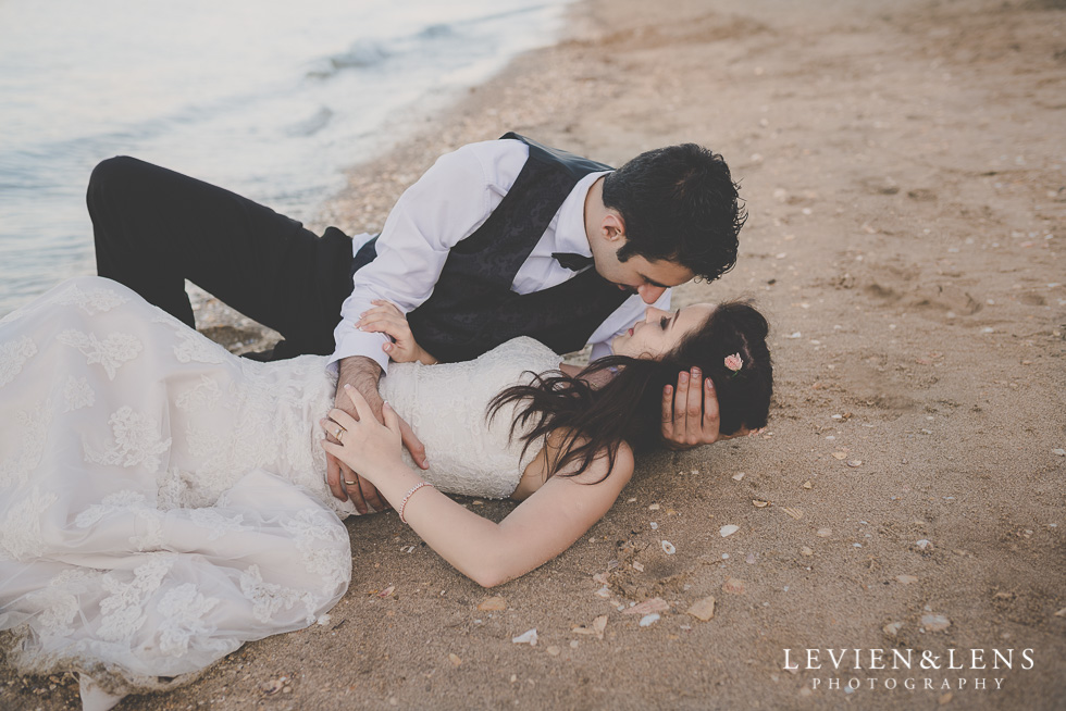 post-wedding session laying on sand St Heliers beach {Auckland-Hamilton-Tauranga wedding photographer}