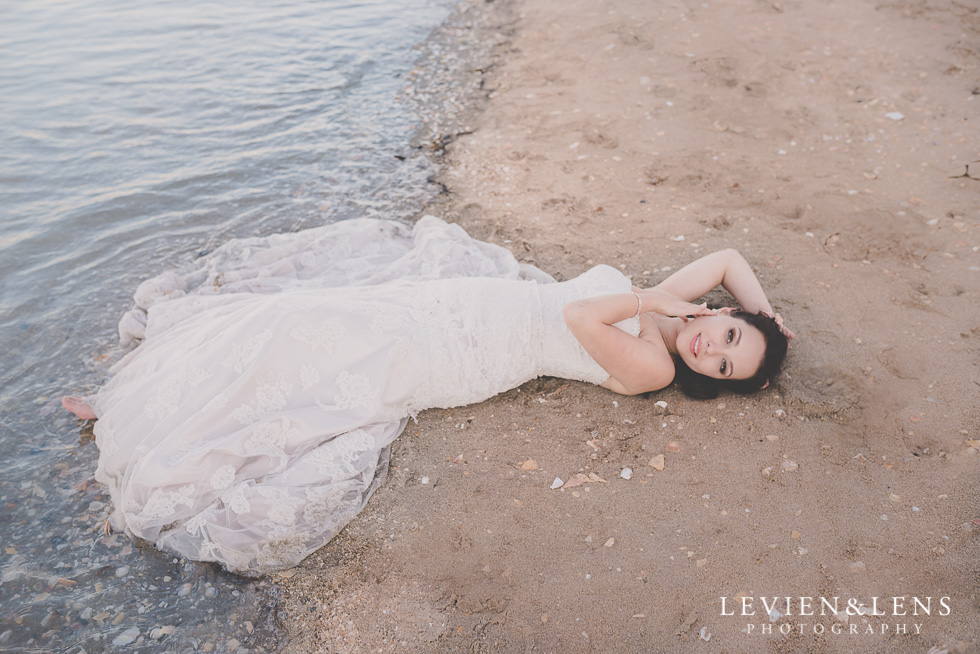 gorgeous bride laying sand St Heliers beach {Auckland-Hamilton-Tauranga wedding photographer}