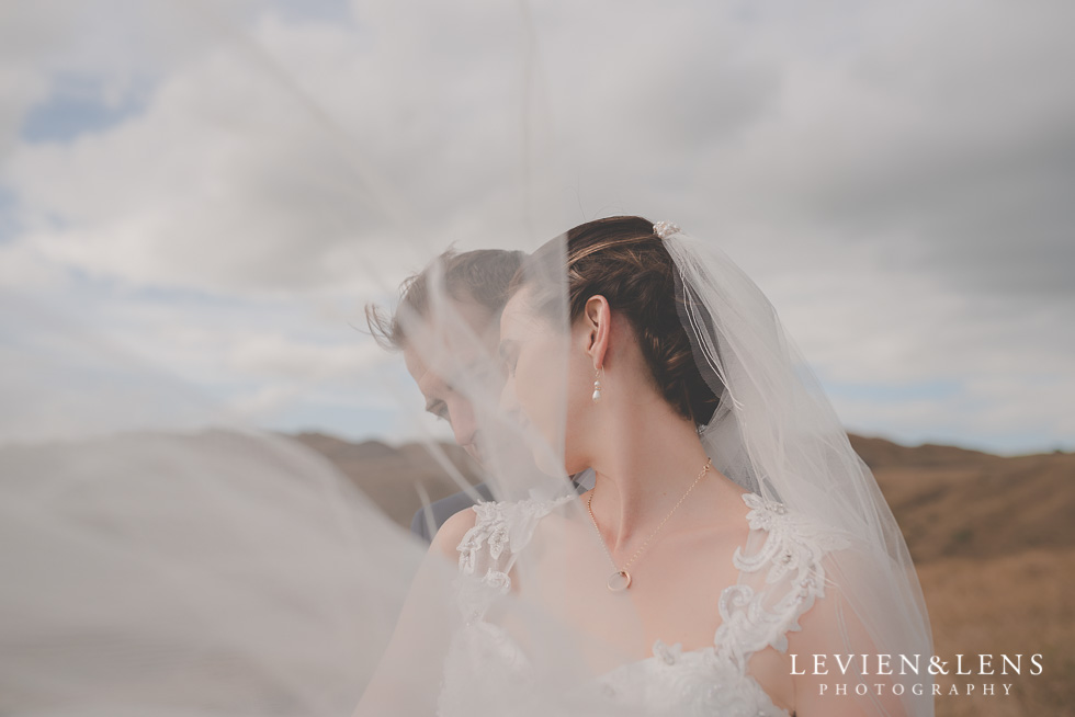 windy veil bride groom location shoot Kariotahi beach Castaways {Auckland wedding-engagement-couples photographer}