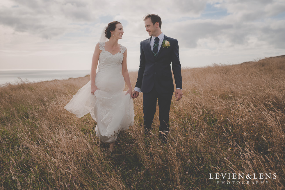bride groom walking - location shoot Kariotahi beach Castaways {Auckland wedding-engagement-couples photographer}