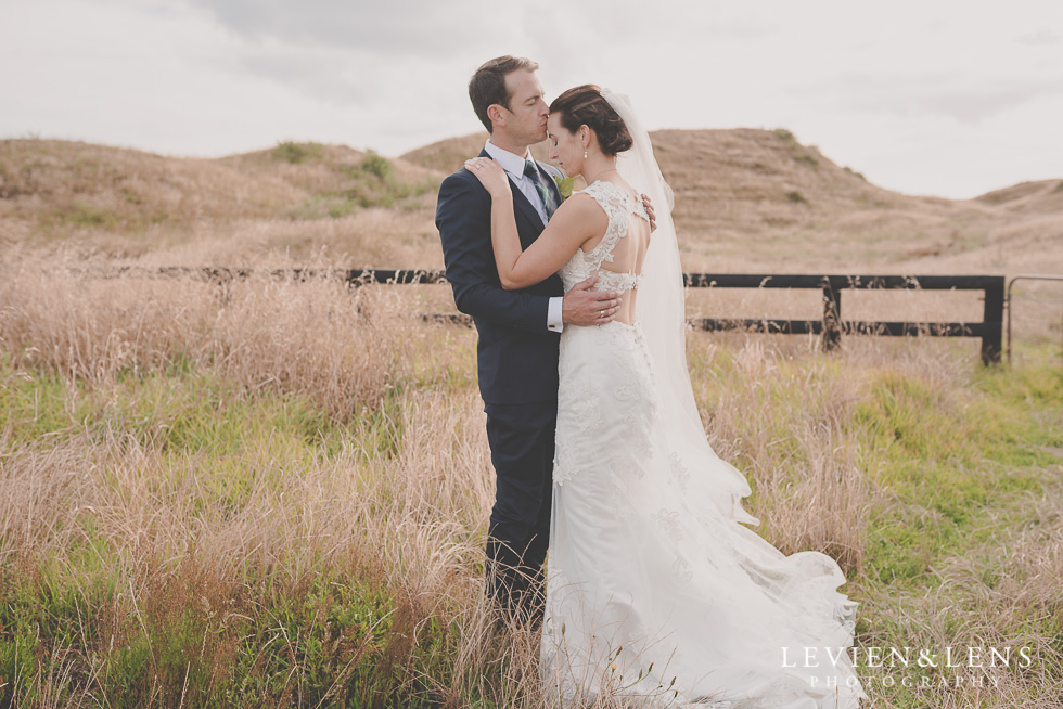 bride groom forehead kiss - location shoot Kariotahi beach Castaways {Auckland wedding-engagement-couples photographer}