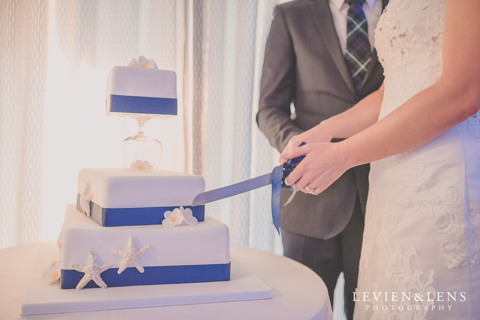 cake cutting reception Castaways {Auckland wedding-engagement-couples photographer}