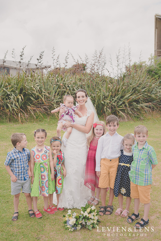 bride with kids Castaways Auckland wedding photographer
