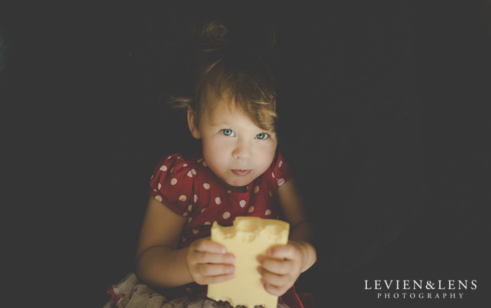 little girl eating cheese 365 Project - January {Auckland-Hamilton lifestyle family-wedding-couples photographer}