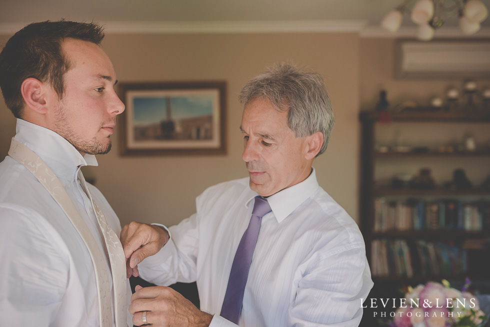 father helping groom getting ready {Auckland-Hamilton-Tauranga wedding photographer}