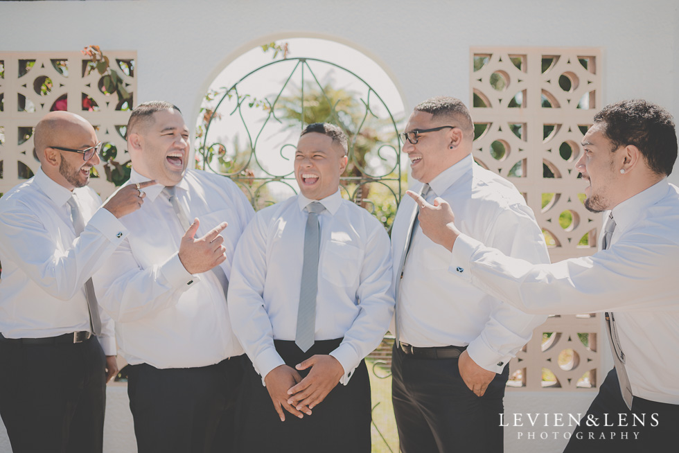 groom with groomsmen getting ready Waitakere Estate {Auckland wedding photographer}