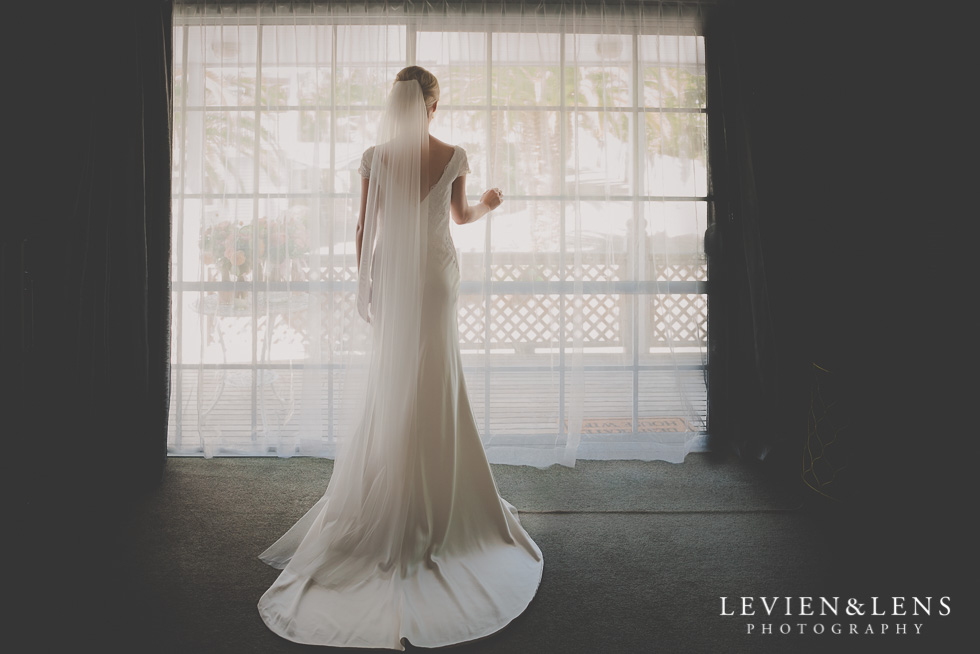 bride at window bride getting ready Kaurilands Estate {Auckland wedding photographer}
