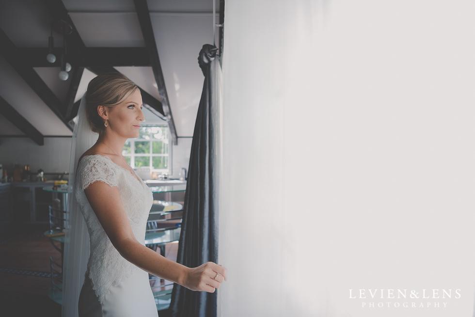 bride near window bride getting ready Kaurilands Estate {Auckland wedding photographer}
