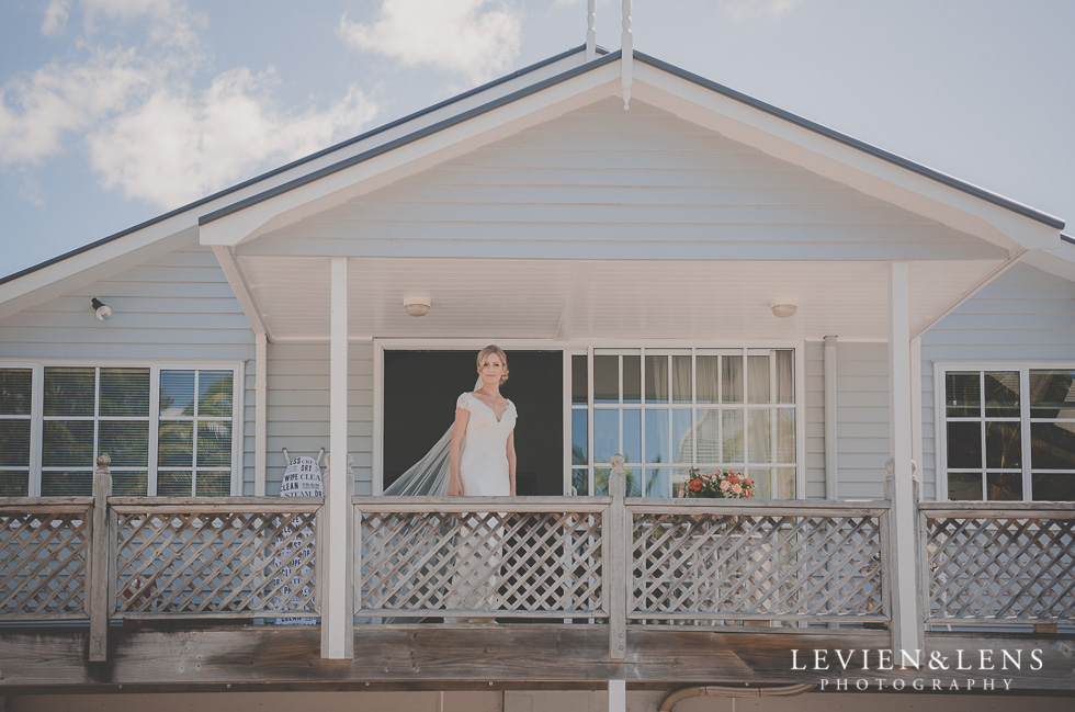 bride standing on balcony bride getting ready Kaurilands Estate {Auckland wedding photographer}