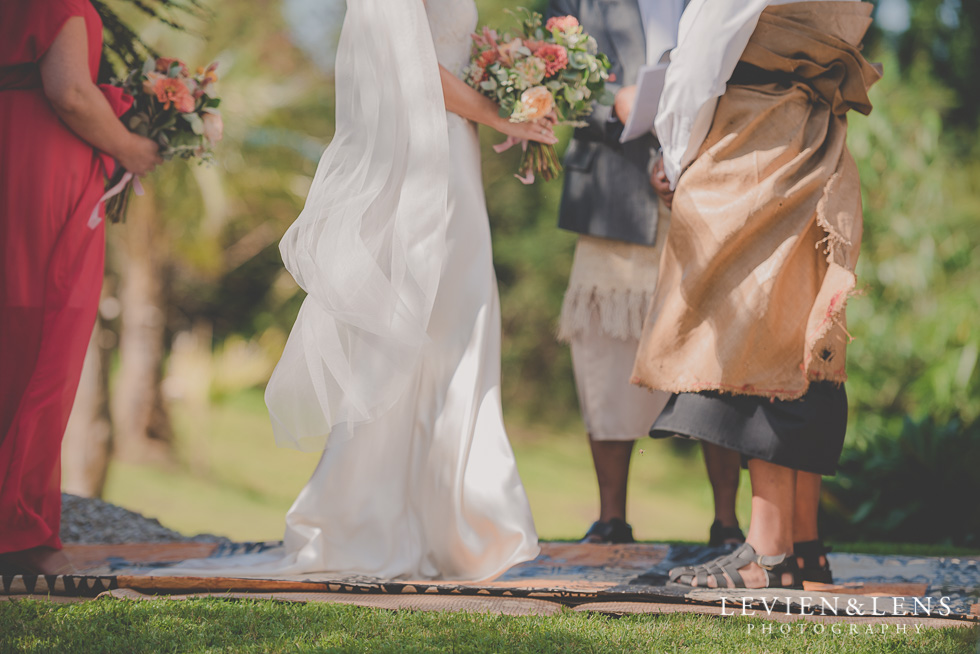 bride and groom on ceremony Landscendt Tropical Garden {Auckland lifestyle wedding photographer}