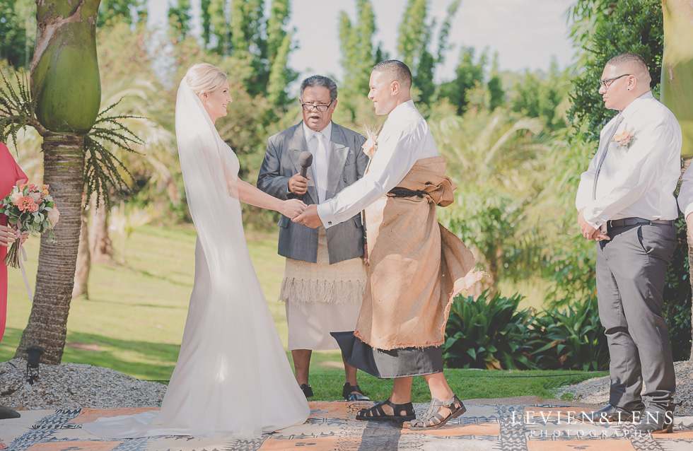 bride and groom happy ceremony Landscendt Tropical Garden {Auckland lifestyle wedding photographer}