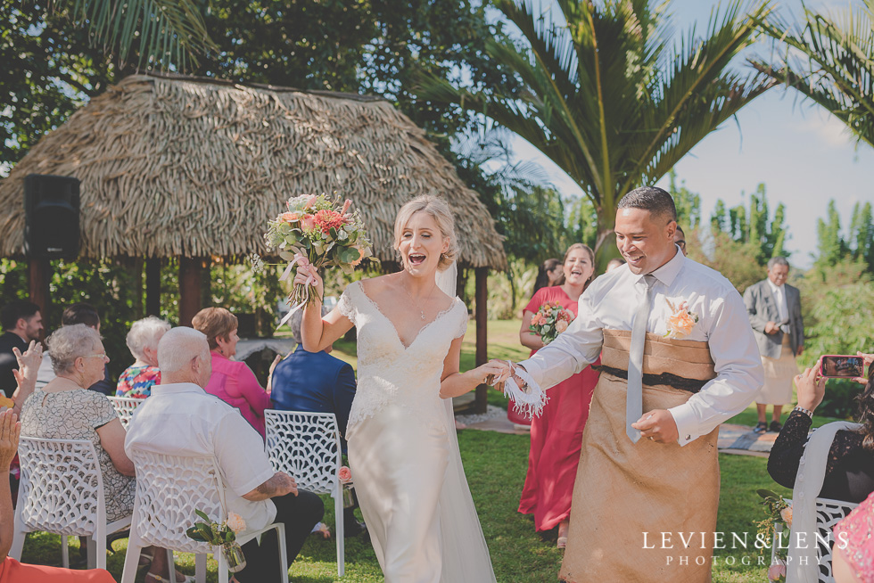bride and groom walking down aisle Landscendt Tropical Garden {Auckland lifestyle wedding photographer}