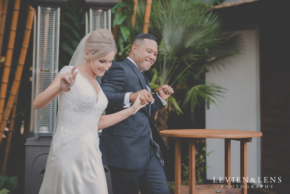 bride and groom enter reception Landscendt Tropical Garden {Auckland wedding photographer}