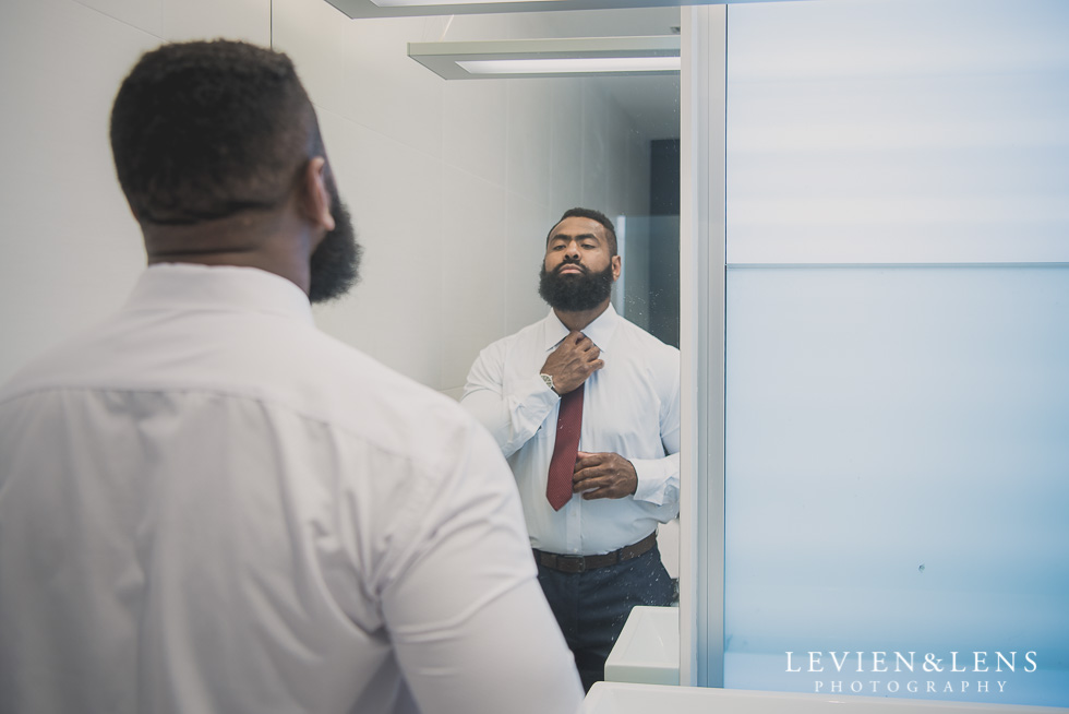 groom getting ready Brigham - Herald Island {Auckland lifestyle wedding photographer}