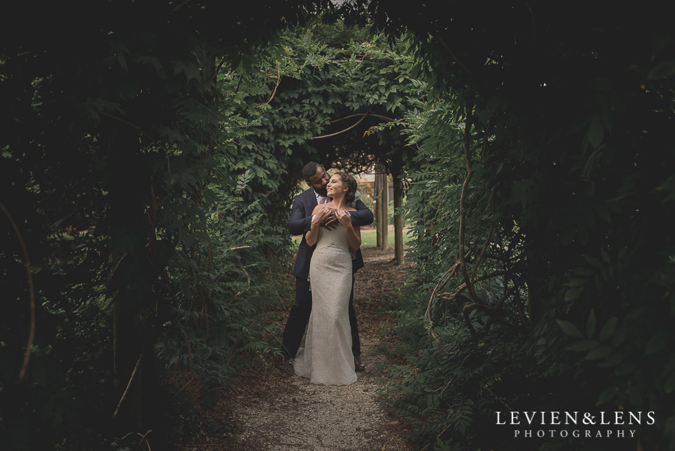 bride and groom in garden tunnel Brigham - Herald Island {Auckland lifestyle wedding photographer}
