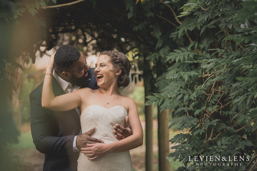 bride and groom laughing Brigham - Herald Island {Auckland lifestyle wedding photographer}