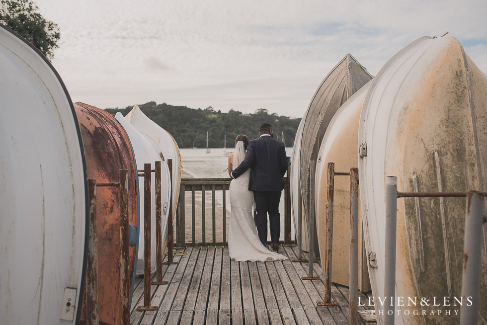 bride and groom near boats Brigham - Herald Island {Auckland lifestyle wedding photographer}
