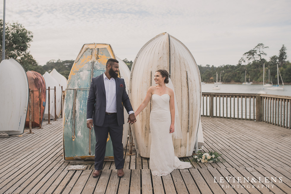 bride groom in front boats Brigham - Herald Island {Auckland lifestyle wedding photographer}