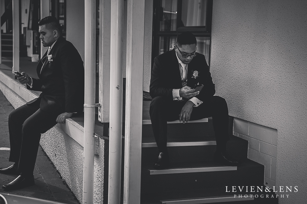 groomsmen sitting on stairs Church Of The Holy Sepulchre - Bastion Point {Auckland NZ lifestyle wedding-engagement photographer}