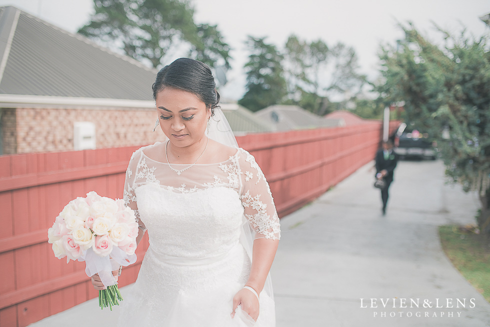bride walking on drivewayChurch Of The Holy Sepulchre - Bastion Point {Auckland NZ lifestyle wedding-engagement photographer}