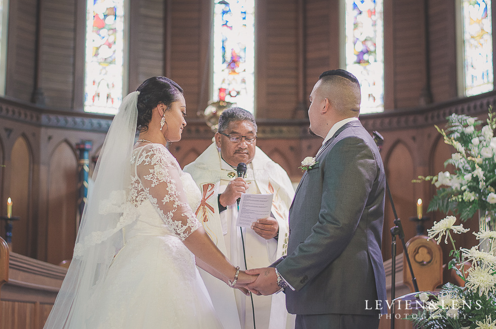 bride and groom holding hands ceremony Church Of The Holy Sepulchre - Bastion Point {Auckland NZ lifestyle wedding-engagement photographer}