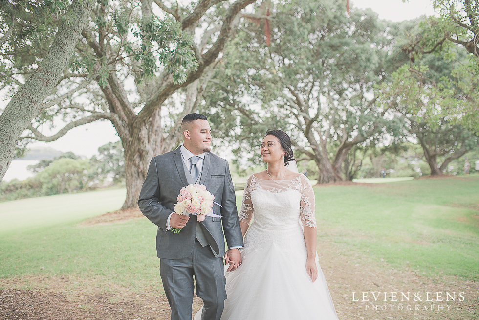 bride and groom walking at park Church Of The Holy Sepulchre - Bastion Point {Auckland NZ lifestyle wedding-engagement photographer}