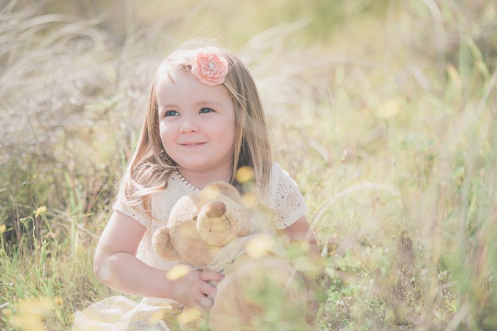girl in grass - Kariotahi beach photo shoot {Auckland lifestyle family-kids photographer}