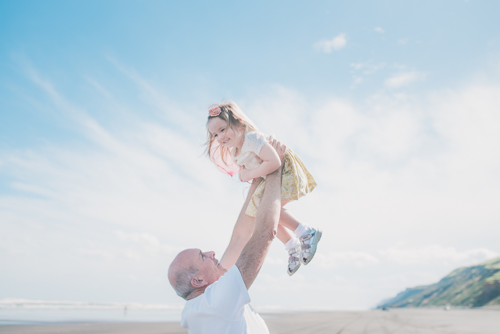 dad holding daughter - Kariotahi beach photo shoot {Auckland lifestyle family-kids photographer}
