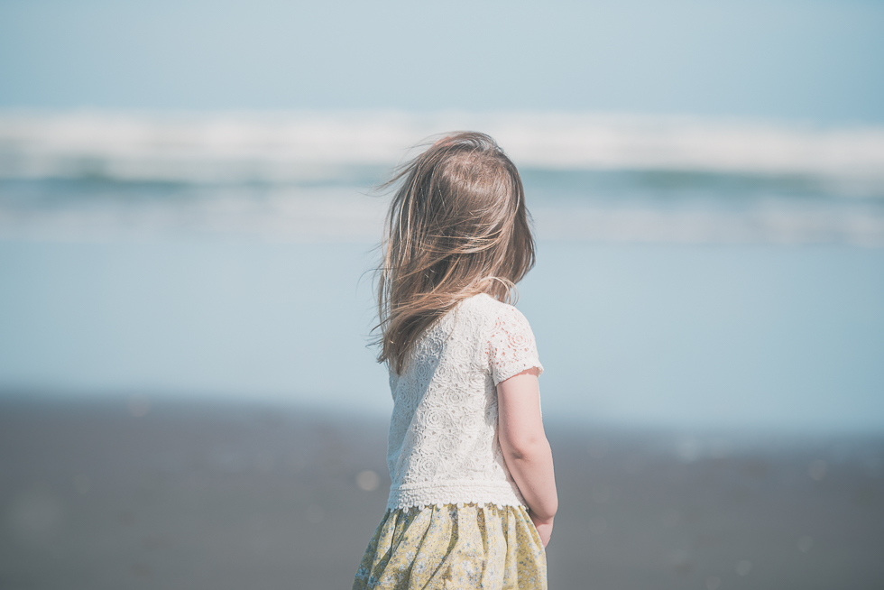 girl near the water Kariotahi beach photo shoot {Auckland lifestyle family-kids photographer}