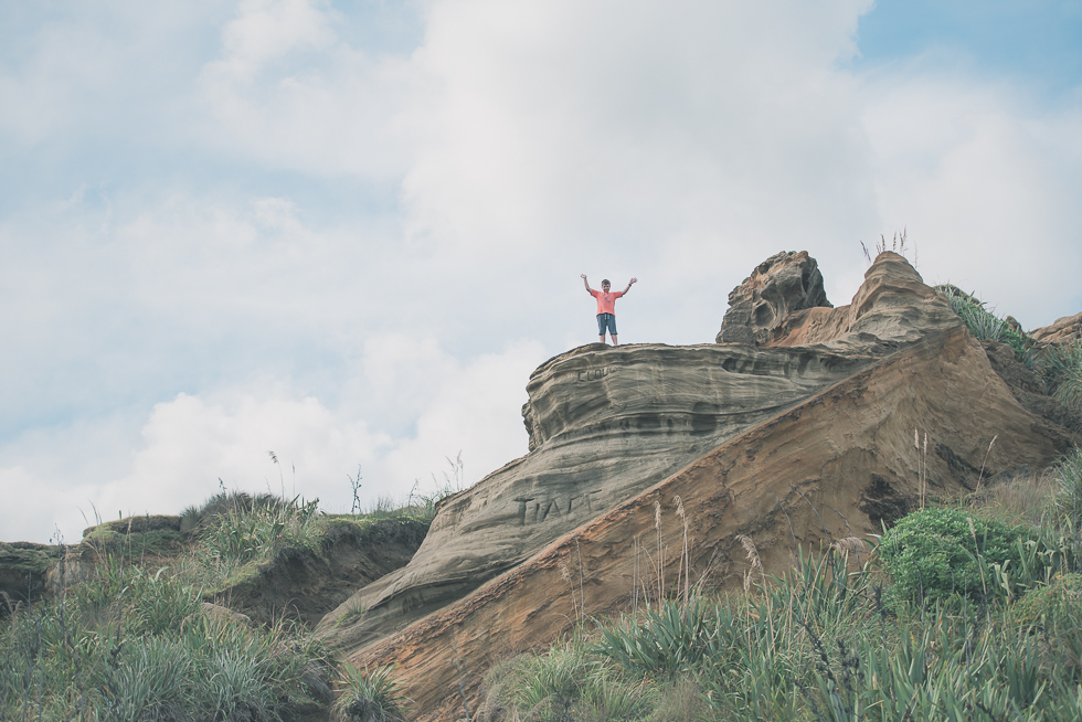 boy on cliff - Kariotahi beach photo shoot {Auckland lifestyle family-kids photographer}