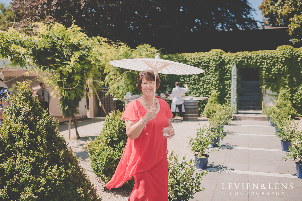mother at ceremony with umbrella Mothers on wedding - Mother's Day feature {New Zealand lifestyle couples-engagement photographer}