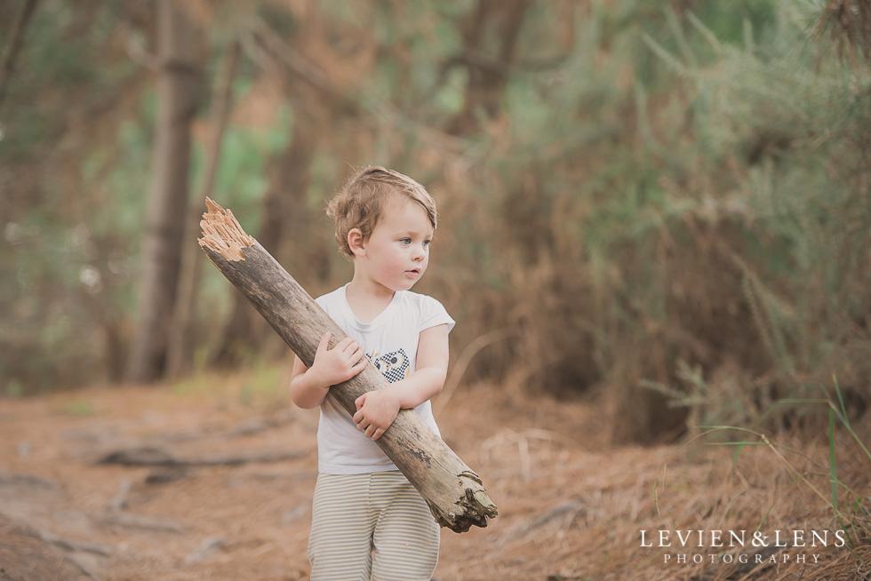 girl with wood Adventures on the bike track {Hamilton NZ lifestyle wedding photographer}