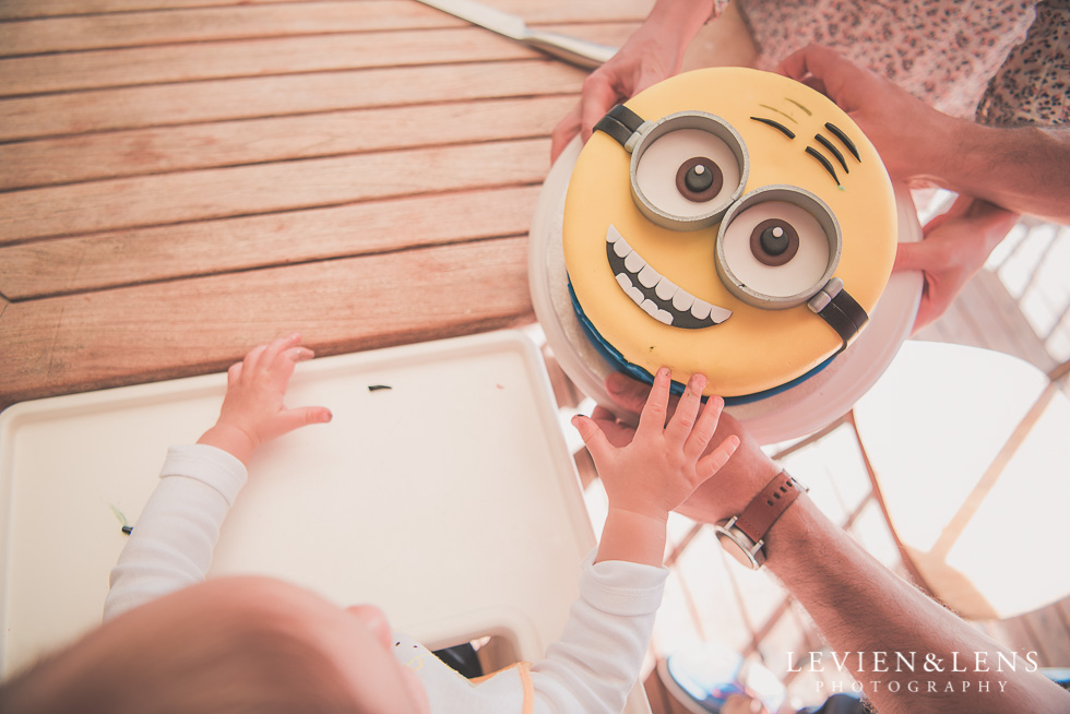 baby and cake Butterfly Creek Minions birthday party {Auckland NZ event photographer} Nazar 1 year old